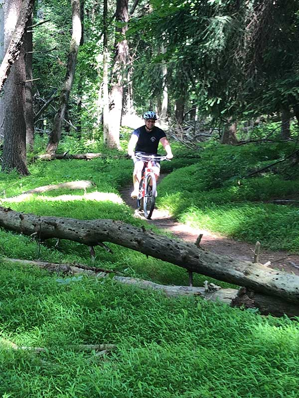 trail biking through the woods